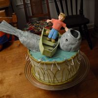 Man Overboard! Sour cream and chocolate pound cake. Fish made of cake and fondant, boat is gum paste and so are the hooks, etc.