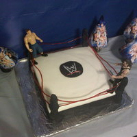 Wwe Ring 3 layered yellow cake, choco frosting covered in mmf, everything edible (excluding wrestlers). Had fun making this cake for my friends wwe...