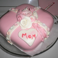 Mom's Bday Cake Lemon cake & Lemon filling covered with MMF. Roses, heart & strips are also MMF with round smartie candies. TFL