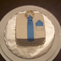 "Small Father's Day Cake small 5"" coconut cake with coconut creme pastry filling and buttercream icing. Fondant tie, pocket, collar and handerkerchief."