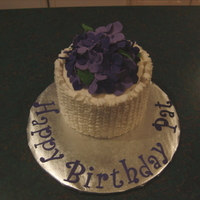 "Purple Hydrangeas And Ruffles Gumpaste hydranges on small 5"" cake with buttercream ruffles. Used mini ball pan for small ball of cake to mound the hydrangeas on."