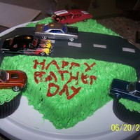 Hot Rod Dad's red velvet cake with cream cheese frosting. my daughter help wight the happy father;s day.