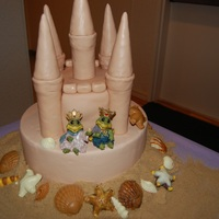 Sand Caslte Wedding Cake This was for a friends wedding, she had a beach theme. The sand castle was for the cutting of the cake but the guests had the cupcakes, 144...
