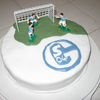 Soccer Cake-Schalke 04 Bday Cake for a friend, simple but neat - 3 Players and a goal and the logo. Schalke 04 is a German Pro Soccer Team.Underneath I put a...