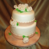 Wedding Cake For Small Reception   Vanilla cake with Hazelnut buttercream. Gumpaste roses.