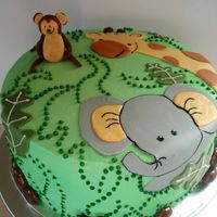 Baby Shower Cake This Almond Joy flavored cake was based on the Mother to Be's Nursery theme - Nojo Bedding in Zoo Friends. The figures are all fondant...
