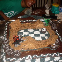 Dirt Bike Cake   I used donuts for the tires,browines for the side ramps,and swiss rolls for the hills.Also use cookies for the dirt