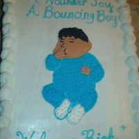 Im000347.jpg This is a cake I did for a baby shower. Baby sucking thumb.