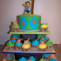 "Go Diego Go Cupcake Tower 6"" Round with Vanilla Buttercream and Fondant. 60 Cupcakes with different Diego Themed decorations. Diego and all decorations are made..."