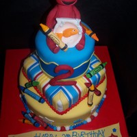 Elmo & Dorothy This is a 3 tier french vanilla cake with buttercream icing covered with fondant. Elmo is also made from fondant