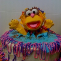 Zoe From Sesame Street  this is a white cake with cream cheese frosting- Zoe is carved from pound cake and covered in fondant. Zoe made me smile the whole time I...