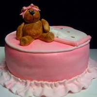 Welcome Baby Girl vanilla bean with lemon and raspberry filling- all covered in fondant. Bear is gumpaste, blanket and ruffle are fondant. All details...