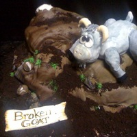 "The 'broken Goat""- A Groom's Cake the 'broken goat' is carved in pound cake and covered in fondant- he sits atop a 'mountain' of chocolate filled..."