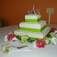 Square Scroll Wedding Cake all buttercream frosting, real ribbon and flowers.