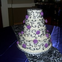 Black Scroll Stacked With Roses. All buttercream except roses, they are gumpaste.. TFL!