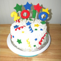"Happy New Year! I looked through lots of CC pics to get ideas for this cake - thanks! It is an 8"" a 3"" yellow cake with vanilla pudding in center..."