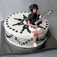 Music Cake With Relaxed Bass Guitar Player Birthday cake decorated with marzipan and a champaign buttercream filling