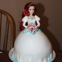 Ariel Birthday Cake For my daughter's 5th birthday! She loves Ariel, and wanted her in her wedding dress! I used the Wilton Wondermold pan, but had to put...