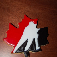Canada Maple Leaf Hockey Cookies Canada Maple Leaf hockey cookies. These went up to Canada to our Toronto office that I work with regularly. Everything was freehand.