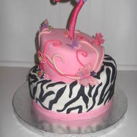 7Th Birthday Cake My niece saw a cake I had made for a baby shower with zebra and pink diamonds on the top layer. I have done that cake four times now, so I...