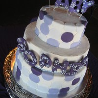 Contemporary Baby Shower Cake Tiered contemporary baby shower cake with purple polka-dots.