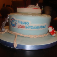 Cruise Ship Cake  My Dad works for Cruise Ship Centers, so I used their logo to create the happy birthday message. Marble cake with whipped vanilla filling,...