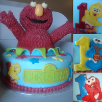 Elmo!!  Elmo marble WASC filled with whipped vanilla pudding and iced in BC. MMF Accents. Elmo's head and arms are RKT, body is cake. Tried...