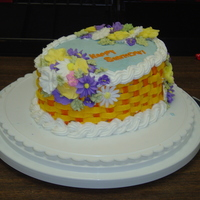 September B-Day Made this cake for my co-workers w/ September b-days. Yellow cake w/ buttercream icing. Flowers are made from royal icing.