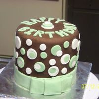 "Dotty Birthday 6"" chocolate chip pound cake with chocolate ganach filling, covered with chocolate fondant, and green and white fondant cutouts. I had..."