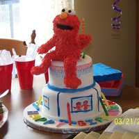 Elmo's World It's Elmo's World!! My son's first birthday cake. I made Elmo out of RK treats and modeling chocolate, and I hand painted...