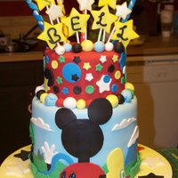 "Micky's Clubhouse This is a cake I did for a friend's daughter, who is a big fan of the Micky Mouse club. It is three tiers, two 8"" tiers, and one..."