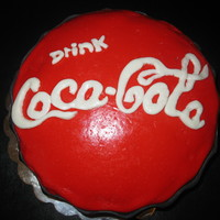 Coca Cola   My niece wanted a coke bottle cap cake for her 14th birthday. It did not turn out like i hoped but she loved it! ;)