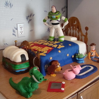 My Turn At Toy Story The bed is a 12x18 sheet. Buzz, Rex, and the toy box is RKT, everything else is fondant. TFL