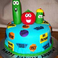 Veggietales Birthday Cake This is a yellow cake covered in fondant. I really couldnt think of a scene for the veggietales to be in so I went simple. I put them on a...