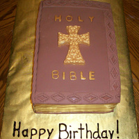 Antique Style Holy Bible Cake This is a yellow cake with fondant and chocolate accents. The cross, text, and page edges are painted in gold luster dust.