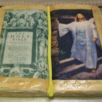 Holy Bible Cake This is a yellow cake. It is in 3D made to look like the Holy Bible. One side is the initial page in the bible and the other side is Christ...