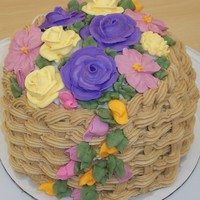 Basket Of Flowers   This summer I decided to re-take the Wilton courses since they updated them. This was my final class cake.
