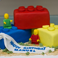 Lego Birthday Cake White & chocolate marble cakes covered in fondant with fondant Lego men