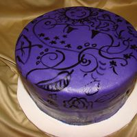 Autumn Cake Two layer chocolate cake with purple fondant on top of purple buttercream. Painting done with black food coloring.