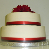 "White And Red With Gerbers   8 & 10"" lemon cake with raspberry BC. Red and black ribbon borders. TFL!"