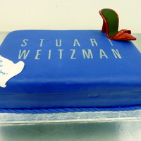 Stuart Weitzman Shoebox  Two 9x13 red velvet cakes stacked. Covered in fondant and the teeny tiny shoe is gumpaste. I printed the logo and cut out the lettering...