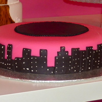 "Pink And Black Birthday Cake  I think they were going for a sex and the city theme...Pink and black fondant over a 10"" red velvet cake with cream cheese icing. TFL..."