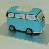 Vw Camper Van  This was a fun cake to do! Two vanilla loafs stacked and carved. Covered in fondant with fondant details and the windows were painted with...