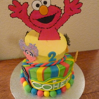 "Elmo Cake This cake was for my son's 2nd birthday. It was all chocolate, 8"" and 6"" topsy turvy tiers. Sesame street characters are all..."