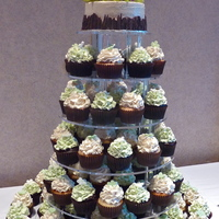 "Green And White Wedding  I think (it was so long ago!) this was 100 cupcakes, choc/mint and lemon/lemon with fondant flowers on each cupcake. 6"" cutting cake..."