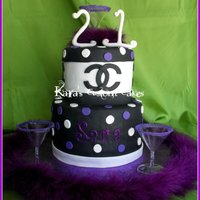 21St Birthday Chanel Cake  21st Birthday cake with Chanel logo around the top tier. Black/white/purple polka dots. Purple sugar rimmed martini glasses (non-edible)....