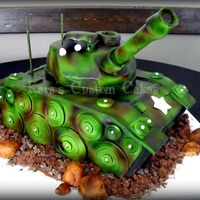 Army Tank Birthday Cake  3D Army Tank cake for a little boy's birthday. Everything is edible besides the back two antennas. The large missile shooter thing (...