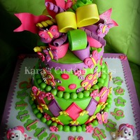 Icing Smiles- Puppy Dogs And Butterflies  This was my 4th cake for Icing Smiles. It was for two sisters who were celebrating their birthdays this month. They recently lost their big...