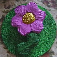 "Flower Cupcake Cake Choc. chip creamcheese filled cupcakes shaped like a flower with BC frosting. I added ""Happy Birthday"" to stem and name in the..."
