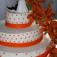 "Orange Tiger Lily Wedding Cake was all white, all buttercream. Customer asked for odd sizes, leaving a 6"" gap between tiers which I think gave it a short, kind..."